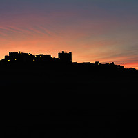 Buy canvas prints of Bamburgh silhouette by Northeast Images