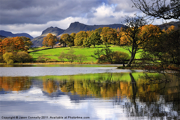 Reflections At Loughrigg Tarn Canvas print by Jason Connolly