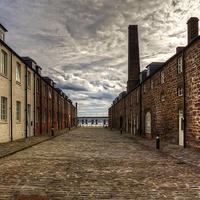 Buy canvas prints of Waterfront Lane by Tom Gomez