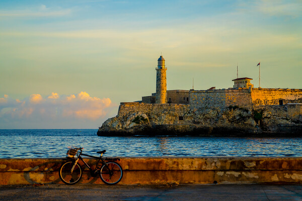 Daybreak On The Havana Malecon Framed Mounted Print by Chris Lord