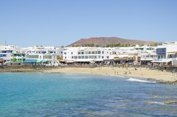 Playa Blanca, Beach and shops Canvas print by Gerry Greer