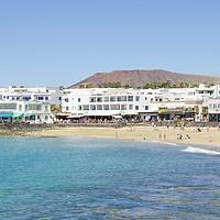 Buy canvas prints of Playa Blanca, Beach and shops by Gerry Greer