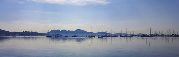 Moody Puerto Pollensa Panorama Canvas print by Gerry Greer