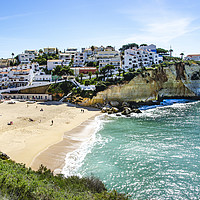 Buy canvas prints of Carvoeiro Beach And Town Algarve by Gerry Greer