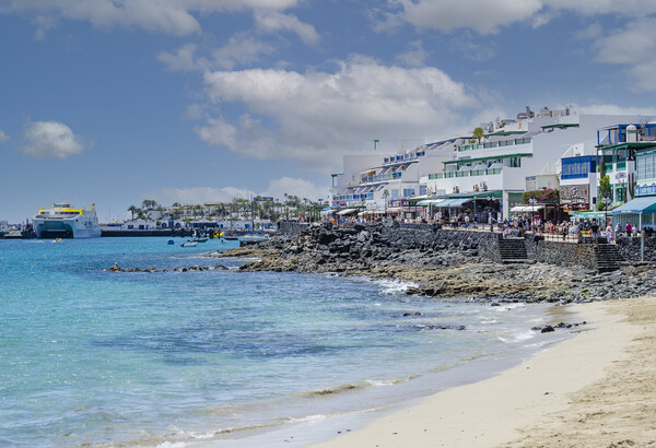 Playa Blanca Town Promenade Lanzarote Canvas Print by Gerry Greer