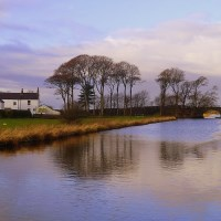 Buy canvas prints of Lancaster Canal at Thurnham. by Lilian Marshall