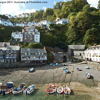 Buy canvas prints of Clovelly harbour. by John Morgan