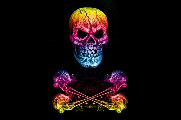 Skull And Crossbones Rainbow Framed Print by Steve Purnell