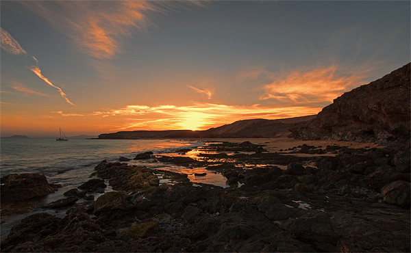 Papagayo Beach Sunset Canvas print by Roger Green