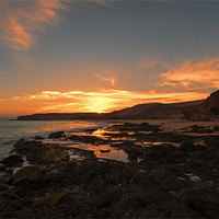 Buy canvas prints of Papagayo Beach Sunset by Roger Green