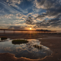 Buy canvas prints of Southport Pier at Sunset by Roger Green