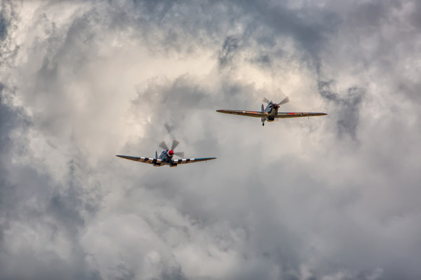 Spitfire and Hurricane Canvas print by Roger Green