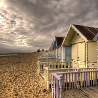 Buy canvas prints of Mersea Island Beach Huts by Nigel Bangert