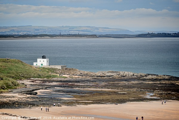 Bamburgh Lighthouse and Beach. Canvas print by Colin Metcalf