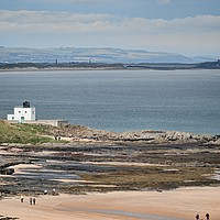 Buy canvas prints of Bamburgh Lighthouse and Beach. by Colin Metcalf