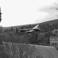 Buy canvas prints of Lancaster PA474 at the Derwent Dam black and white by Gary Eason + Flight