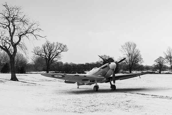 Spitfire in the snow black and white version Canvas Print by Gary Eason + Flight