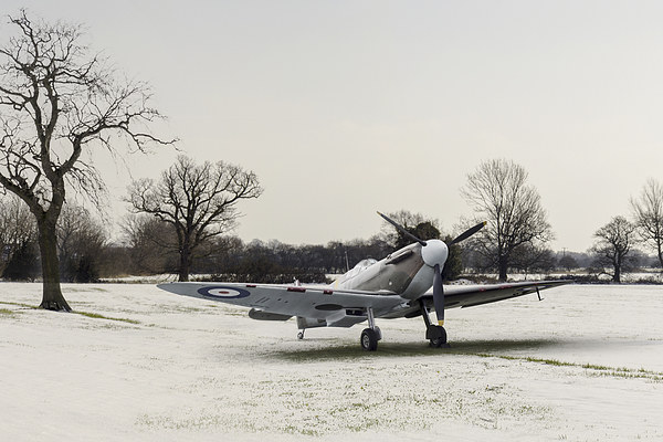 Spitfire in the snow Canvas Print by Gary Eason + Flight
