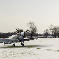 Buy canvas prints of Spitfires in the snow by Gary Eason + Flight