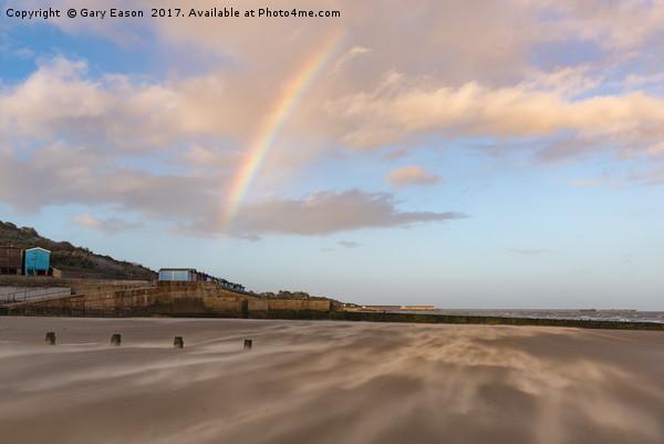 Rainbow over windblown sand on Frinton Beach Canvas print by Gary Eason