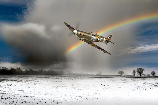 Spitfire with snow shower rainbow Canvas Print by Gary Eason