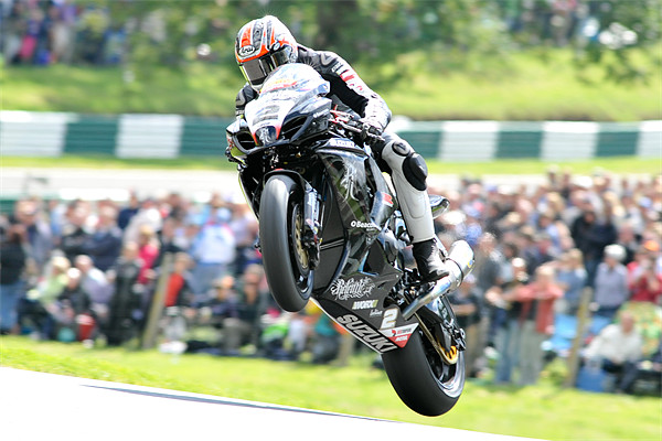 Josh Brookes - Take Off at Cadwell park 2011 Canvas print by SEAN RAMSELL