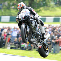 Buy canvas prints of Josh Brookes - Take Off at Cadwell park 2011 by SEAN RAMSELL