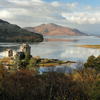 Buy canvas prints of Eilean Donan Castle Panorama in Autumn by Grant Glendinning