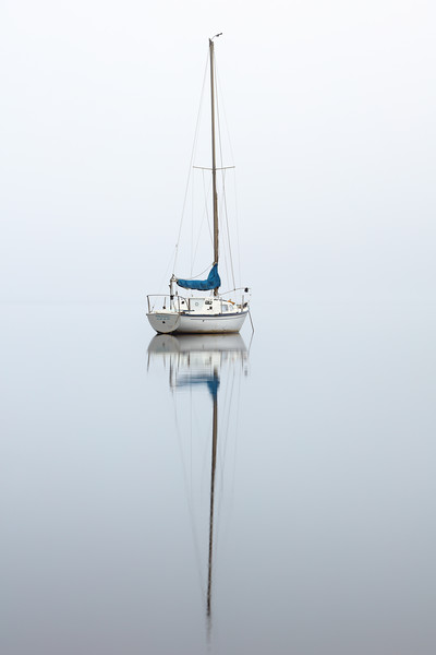Misty boat Canvas Print by Grant Glendinning