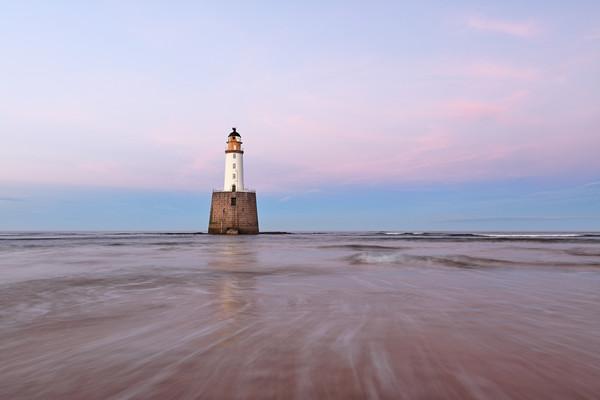 Lighthouse Sunset Canvas Print by Grant Glendinning