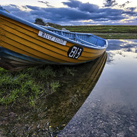 Buy canvas prints of Old clinker built salmon boat by Dave Wilkinson  North Devon Photography