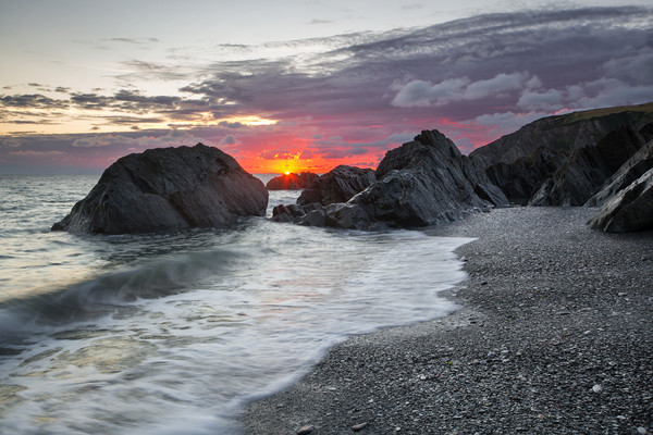 Sandy Cove Sunrise. Canvas print by Dave Wilkinson North Devon Ph