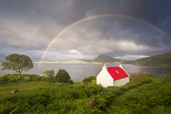 Applecross Red Roofed Cottage with Rainbows Canvas print by Derek Beattie