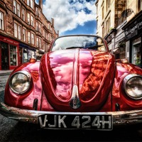 Buy canvas prints of Vintage Beetle on the street by Fine Art by John Farnan