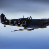 Buy canvas prints of Spitfire in Flight by DSLR Creations