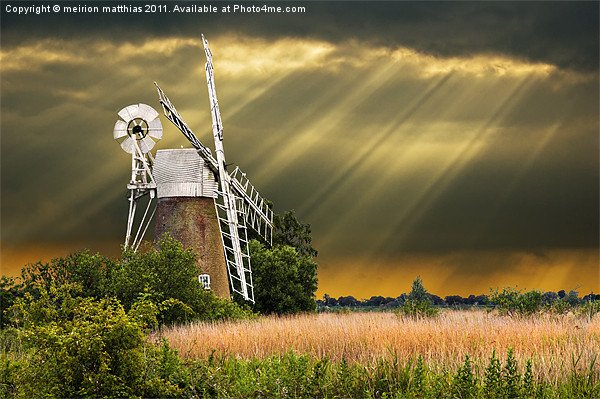 windmill with sunbeams Canvas Print by meirion matthias