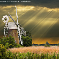 Buy canvas prints of windmill with sunbeams by meirion matthias