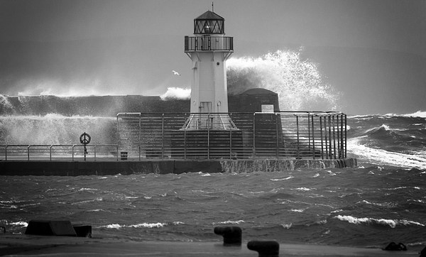 Ardrossan Lighthouse Versus the Sea Canvas print by Fiona Messenger