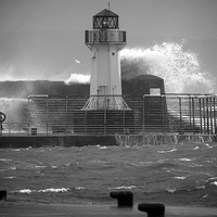 Buy canvas prints of Ardrossan Lighthouse Versus the Sea by Fiona Messenger