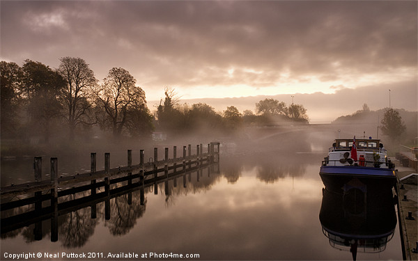 Mist on the Thames Canvas print by Neal Puttock
