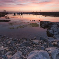 Buy canvas prints of Sunset on the Rocks by Bill Buchan