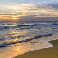 Buy canvas prints of  Glyfada Golden Sunset by Bill Buchan