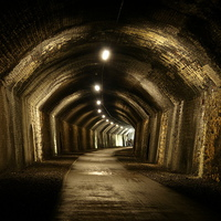 Buy canvas prints of Chee Tor No 1 Tunnel, Derbyshire, Monsal Trail by Chris Petty