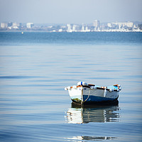Buy canvas prints of Boat in Poole Harbour by Paul Brewer