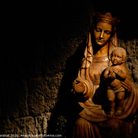 Buy canvas prints of Madonna and Jesus statue illuminated by Greg Marshall