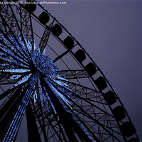 Buy canvas prints of Blue Star Wheel by Iona Semay