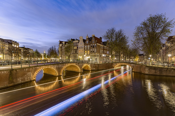 Amsterdam canal by night Canvas print by Charlie Brown