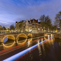 Buy canvas prints of Amsterdam canal by night by Charlie Brown