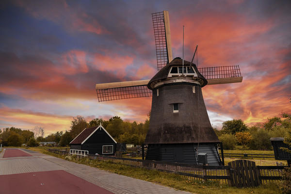 Sunset over a Dutch windmill  Canvas print by Charlie Brown