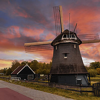 Buy canvas prints of Sunset over a Dutch windmill  by Charlie Brown